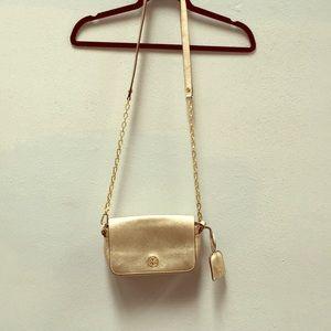 Tori Burch gold clutch & keychain from Neiman's